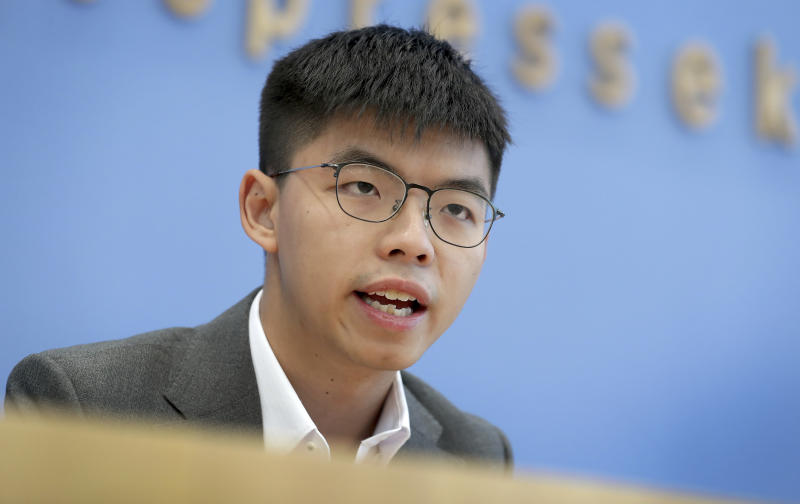 FILE - In this Sept. 11, 2019, file photo, Hong Kong activist Joshua Wong addresses the media during a press conference in Berlin, Germany. Overseas, Joshua Wong has emerged as a prominent face of Hong Kong's months-long protests for full democracy. At home, he is just another protester. (AP Photo/Michael Sohn, File)