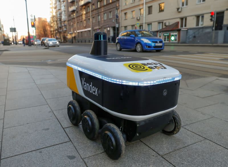 FILE PHOTO: Yandex robots deliver restaurant meals in central Moscow