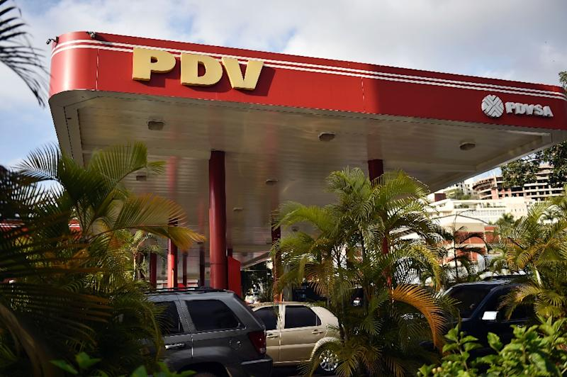 The US sanctions will make it difficult for Venezuela's state-owned PDVSA to import products necessary to produce petrol for domestic use in addition to complicating exports of crude oil (AFP Photo/Luis ROBAYO)