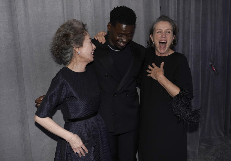 "Yuh-Jung Youn, from left, winner of the award for best actress in a supporting role for ""Minari,"" Daniel Kaluuya, winner of the award for best actor in a supporting role for ""Judas and the Black Messiah,"" and Frances McDormand, winner of the award for best actress in a leading role for ""Nomadland,"" pose outside the press room at the Oscars on Sunday, April 25, 2021, at Union Station in Los Angeles. (AP Photo/Chris Pizzello, Pool)"