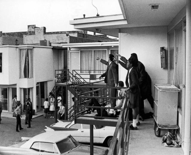<p>Dr. Ralph Abernathy and Jesse Jackson (both obscured) and others stand on the balcony of the Lorraine Motel and point in the direction of gun shots that killed Dr. Martin Luther King Jr., who lies at their feet, Memphis, Tenn., April 4, 1968. (Photo: Joseph Louw/The LIFE Images Collection/Getty Images) </p>