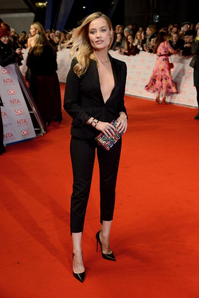 <p>Who says you need a dress for the red carpet? We are seriously lusting over Laura Whitmore's two-piece suit at this year's National Television Awards. <em>[Photo: Getty]</em> </p>
