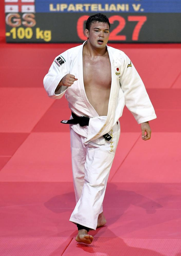 """FILE - Aaron Wolf of Japan walks off the mat after winning against Varlam Liparteliani of Georgia in the men's 100kg category at the World Judo Championships in Budapest, Hungary, in this Saturday, Sept. 2, 2017, file photo. Judo is coming home at the Tokyo Olympics """"It's such a lucky opportunity to attend the Olympics in Japan where judo was born,"""" Japanese Olympian Aaron Wolf recently told Japan's Sportiva magazine. """"I want to win on this stage. My goal is a gold medal."""" (Tibor Illyes/MTI via AP, File)"""