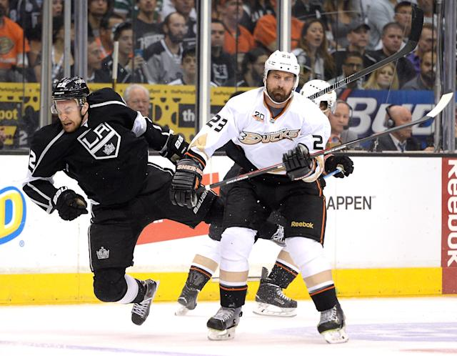 LOS ANGELES, CA - MAY 14: Francois Beauchemin #23 of the Anaheim Ducks checks Trevor Lewis #22 of the Los Angeles Kings during the first period in Game Six of the Second Round of the 2014 NHL Stanley Cup Playoffs at Staples Center on May 14, 2014 in Los Angeles, California. (Photo by Harry How/Getty Images)