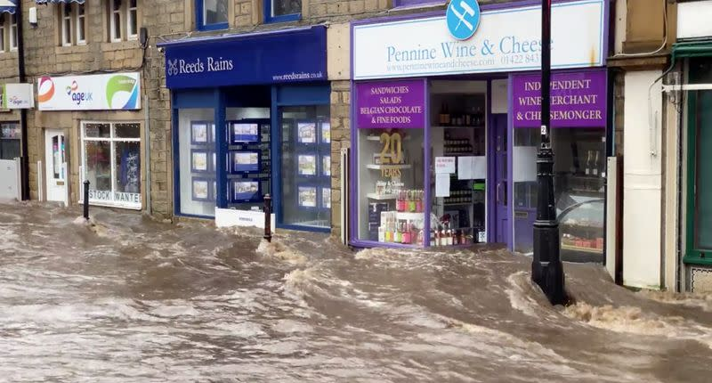 A flooded street is seen after Storm Ciara downpour in Hebden Bridge