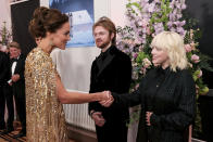 Britain's Kate, the Duchess of Cambridge, left, speaks with performers Finneas O'Connell and Billie Eilish upon arrival for the World premiere of the new film from the James Bond franchise 'No Time To Die', in London, Tuesday, Sept. 28, 2021. (Chris Jackson/Pool Photo via AP)
