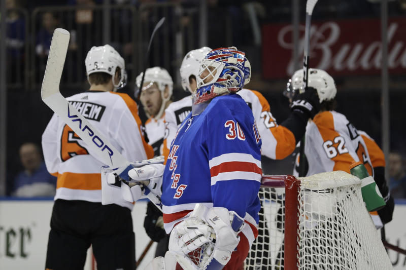 New York Rangers goaltender Henrik Lundqvist reacts after being scored on by the Philadelphia Flyers during the first period of the NHL hockey game, Sunday, March 1, 2020, in New York. (AP Photo/Seth Wenig)