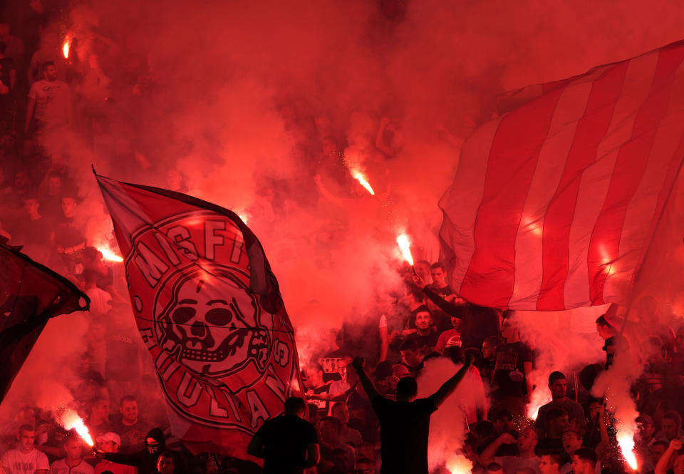 Red Star fans light fireworks during a Serbian National soccer league derby match between Partizan and Red Star in Belgrade, Serbia, Sunday, Sept. 19, 2021. (AP Photo/Darko Vojinovic)