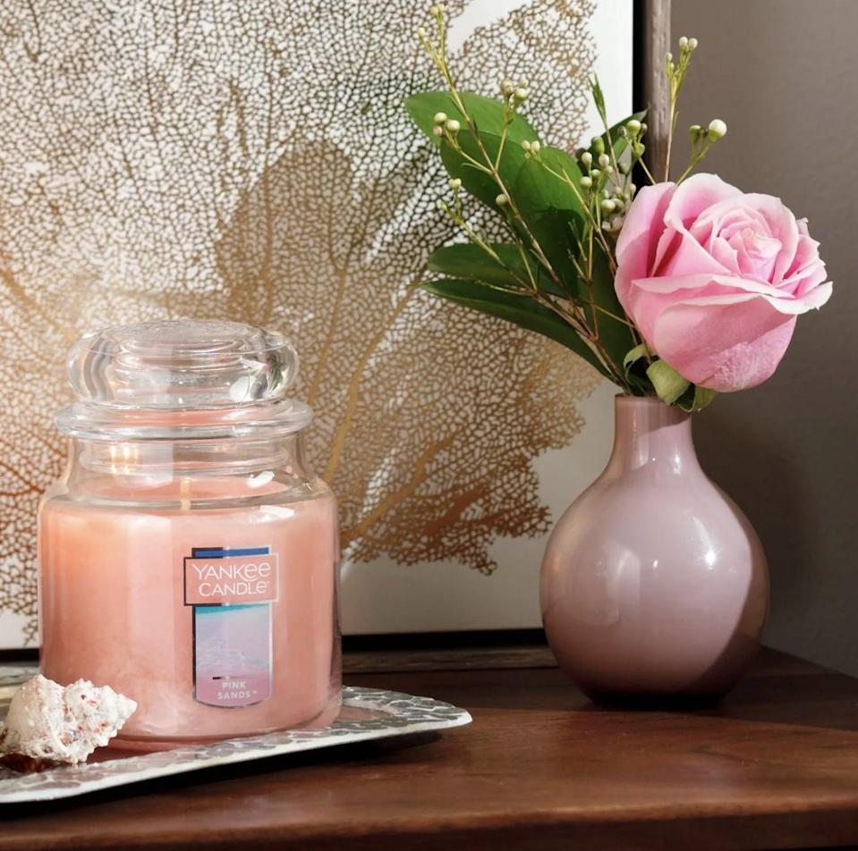 <p>This large <span>Pink Sands Glass Jar Pink Sands Candle</span> ($13) can burn for hours, so light it whenever you please.</p>