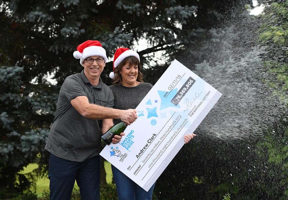 Andrew Clark, 51, from Boston, Lincolnshire, with his partner Trisha Fairhurst, celebrates his £76,369,806.80 EuroMillions jackpot win from the draw on Friday 2 November 2018 at Belton Woods Hotel, Grantham.