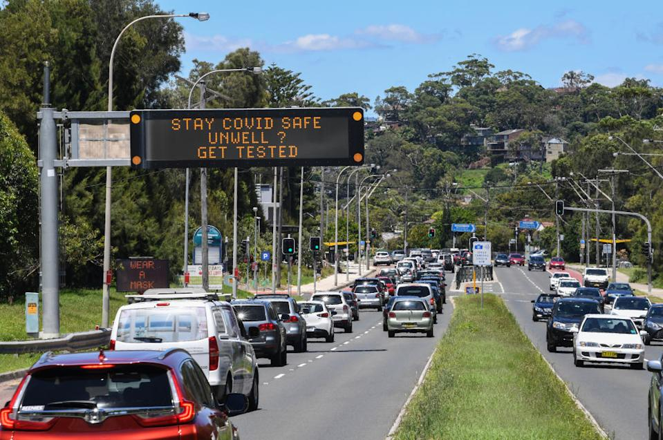 Traffic heading towards the city are warned about Covid-19 on digital displays at North Narrabeen in Sydney.