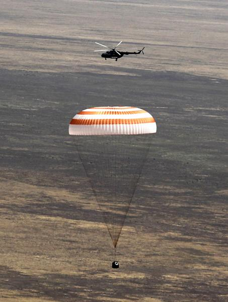 A Russian Soyuz TMA-03M space capsule lands about 150 kms south-east of the Kazakh town of Dzhezkazgan, Kazakhstan, Sunday, July 1, 2012. The Soyuz capsule, which carried U.S. astronaut Donald Pettit, Russian cosmonaut Oleg Kononenko, and Netherlands' astronaut Andre Kuipers safely returned to Earth on Sunday after a half-year stint on the international space station, with a landing on the Kazakh steppe. (AP Photo/Mikhail Metzel, pool)