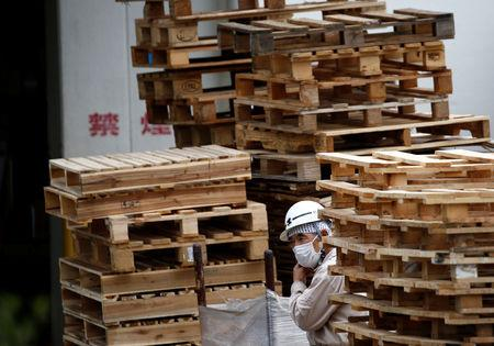 FILE PHOTO: A worker takes a rest at a warehouse at the Keihin Industrial Zone in Kawasaki, Japan September 12, 2018. REUTERS/Kim Kyung-Hoon