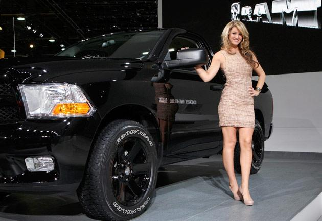 Model Lisa Belczak poses by a 2012 Ram 1500 pick up truck on the final press preview day for the North American International Auto Show in Detroit, Michigan, January 10, 2012. REUTERS/Rebecca Cook