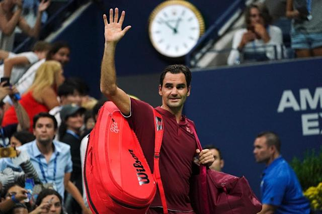 It's all over: Roger Federer waves as he walks off court after losing to Australia's John Millman in the fourth round (AFP Photo/EDUARDO MUNOZ ALVAREZ)