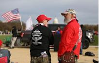 """Militia members and pro-gun rights participating in the """"Declaration of Restoration"""" rally listen to speakers in Washington, D.C."""