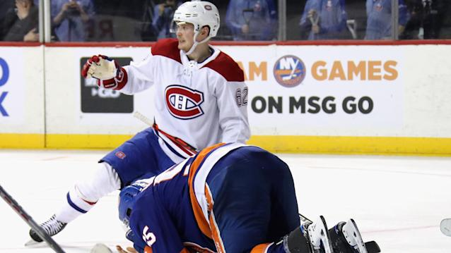 Johnny Boychuk's face was sliced by an errant skate during Tuesday's game against the Montreal Canadiens. (Bruce Bennett/Getty Images)
