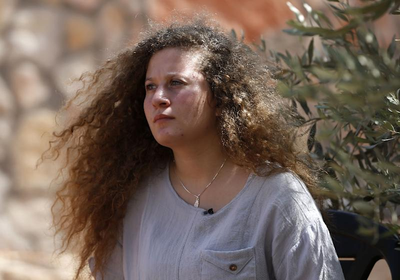 Palestinian activist Ahed Tamimi, 17, listens during an interview with Agence France-Presse (AFP) in the West Bank village of Nabi Saleh on July 30, 2018