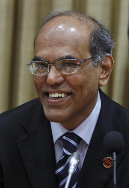 Reserve Bank of India (RBI) Governor Duvvuri Subbarao smiles during a meeting with bankers at the RBI head office in Mumbai, India, Tuesday, April 17, 2012. The RBI slashed India's key interest rate by half a percentage point Tuesday, the first cut in three years and more than economists had expected. (AP Photo/Rafiq Maqbool)