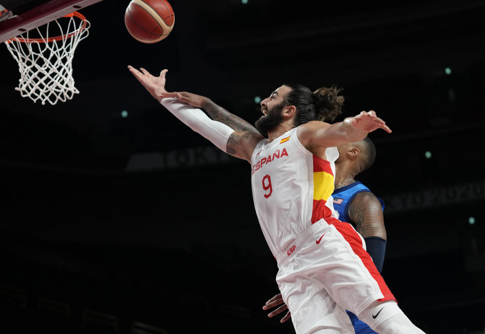 United States' Damian Lillard (6), rear, and Spain's Ricky Rubio (9) fight for the ball during men's basketball quarterfinal game at the 2020 Summer Olympics, Tuesday, Aug. 3, 2021, in Saitama, Japan. (AP Photo/Eric Gay)