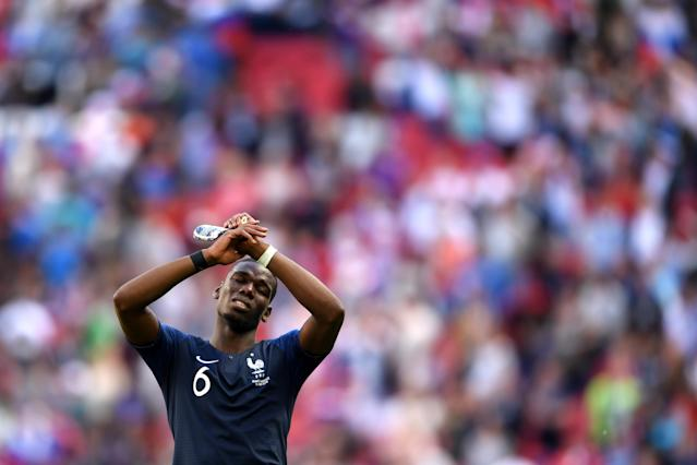 <p>Job done for France as Paul Pogba shows his relief at the end </p>