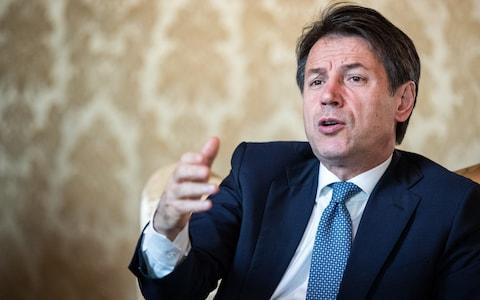 Giuseppe Conte speaking during an interview on Tuesday - Credit: Alessia Pierdomenico/Boomberg