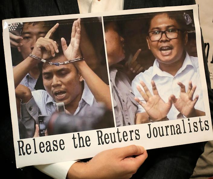 A protester holds a placard outside the Myanmar consulate in Hong Kong after a Myanmar court sentenced two Reuters journalists to seven years in prison. (Photo: ASSOCIATED PRESS)