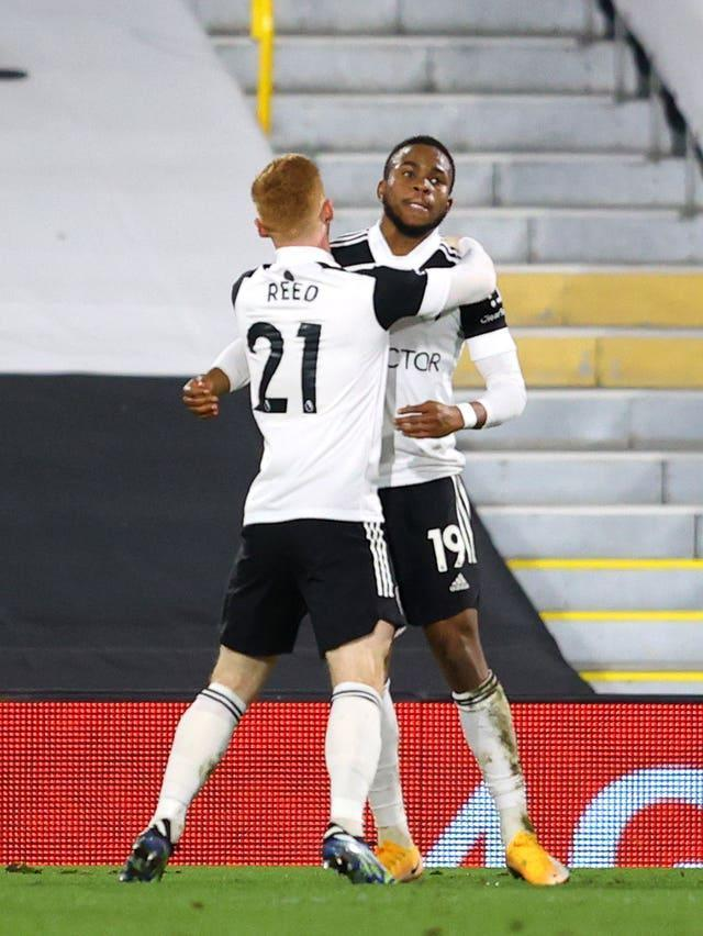 Ademola Lookman celebrates with team mate Harrison Reed after putting Fulham in front against relegation rivals Sheffield United.