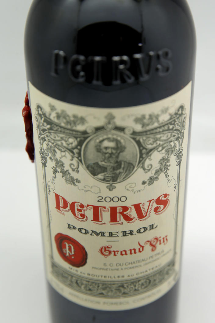 A bottle of Petrus red wine that spent a year orbiting the world in the International Space Station is pictured in Paris Monday, May 3, 2021. Christie's said Tuesday May 4, 2021, they are offering the bottle of French wine for a private sale, with a stratospheric price tag in the region of euro 1 million. (AP Photo/Christophe Ena)