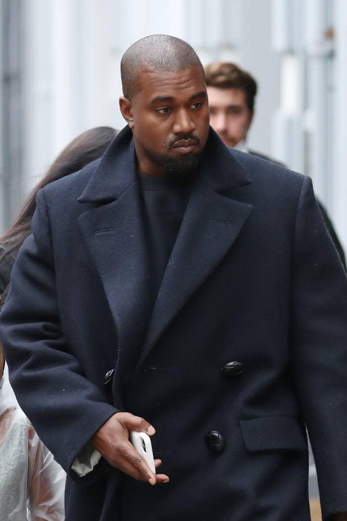 Kanye West is pictured walking outside in London