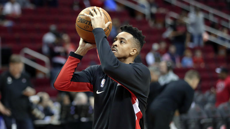 Portland Trail Blazers guard CJ McCollum warms up before he start of an NBA basketball game Wednesday, Jan. 15, 2020, in Houston. (AP Photo/Michael Wyke)