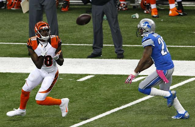 Cincinnati Bengals wide receiver A.J. Green (18) makes an 82-yard touchdown reception as Detroit Lions cornerback Chris Houston (23) defends in the first quarter of an NFL football game Sunday, Oct. 20, 2013, in Detroit. (AP Photo/Paul Sancya)