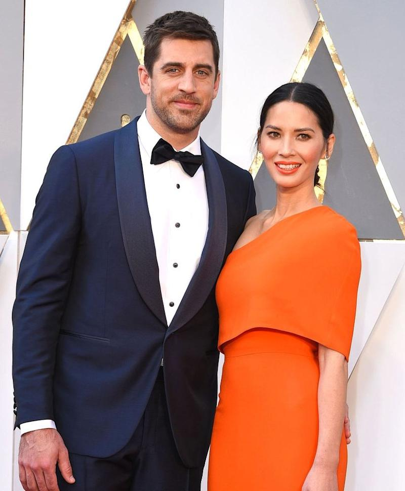 Aaron Rodgers (left) and Olivia Munn