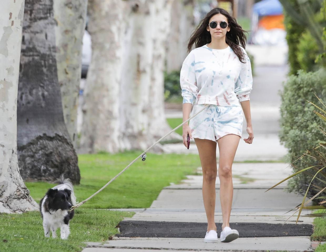 <p>A solo Nina Dobrev goes for a walk with her pup in Los Angeles on Wednesday.</p>