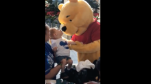 Winnie the Pooh spent 10 minutes comforting a disabled little boy at Disney World, and the video will break your heart