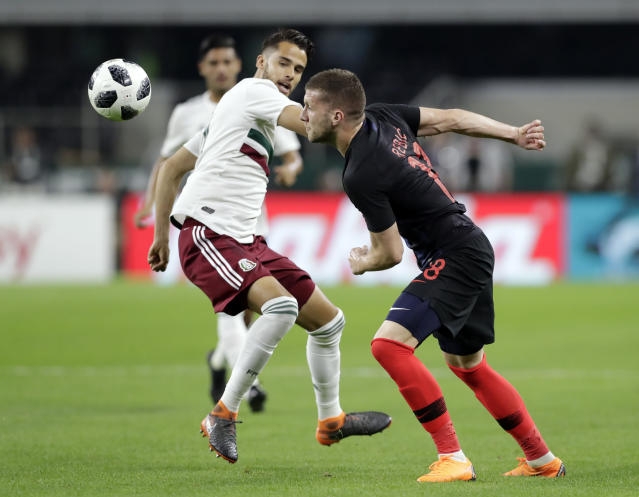 CORRECTS DATE OF PHOTO - Croatia forward Ante Rebic, right, chases after a loose ball in front of Mexico defender Diego Reyes (5) during the first half of a friendly soccer match in Arlington, Texas, Tuesday, March 27, 2018. (AP Photo/Tony Gutierrez)