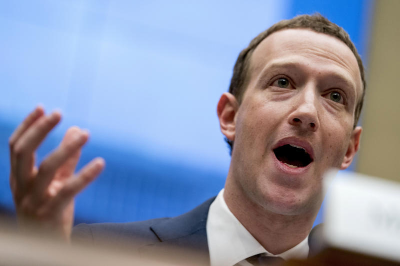 """FILE - In this April 11, 2018, file photo Facebook CEO Mark Zuckerberg testifies before a House Energy and Commerce hearing on Capitol Hill in Washington. Twitter's ban on political advertising is ratcheting up the pressure on Facebook and Zuckerberg to follow suit. Zuckerberg doubled down on Facebook's approach in a call with analysts Wednesday, Oct. 30, 2019, he reiterated Facebook's stance that """"political speech is important."""" (AP Photo/Andrew Harnik, File)"""
