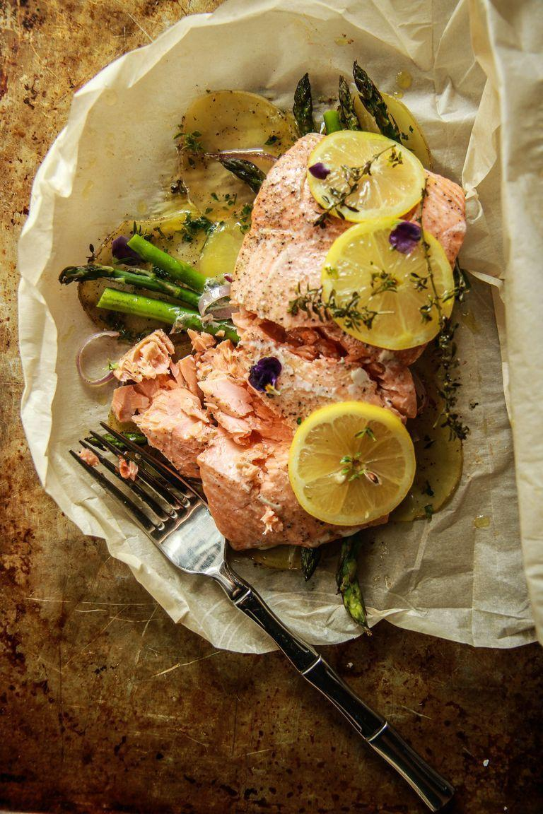 """<p>You'll never have to worry about overcooking salmon again once you try this smart parchment paper method. The fish cooks right on top of the vegetables, and the whole meal is ready in less than 20 minutes.</p><p><strong>Get the recipe from <a href=""""https://www.thepioneerwoman.com/food-cooking/recipes/a85510/how-to-perfectly-cook-salmon/"""" rel=""""nofollow noopener"""" target=""""_blank"""" data-ylk=""""slk:Heather Christo"""" class=""""link rapid-noclick-resp"""">Heather Christo</a>.</strong></p><p><a class=""""link rapid-noclick-resp"""" href=""""https://www.amazon.com/Reynolds-Kitchens-Parchment-Non-Stick-Square/dp/B07F6F631N/ref=sr_1_1_sspa?tag=syn-yahoo-20&ascsubtag=%5Bartid%7C2164.g.37023193%5Bsrc%7Cyahoo-us"""" rel=""""nofollow noopener"""" target=""""_blank"""" data-ylk=""""slk:SHOP PARCHMENT PAPER"""">SHOP PARCHMENT PAPER</a></p>"""
