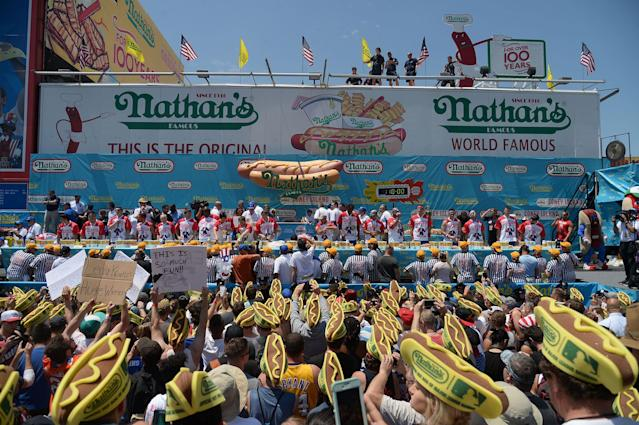 <p>Competitors ready themselves for the start of the Nathan's Famous Fourth of July International Hot Dog-Eating Contest at Coney Island in Brooklyn, New York City, U.S., July 4, 2017. (Erik Pendzich/REX/Shutterstock) </p>