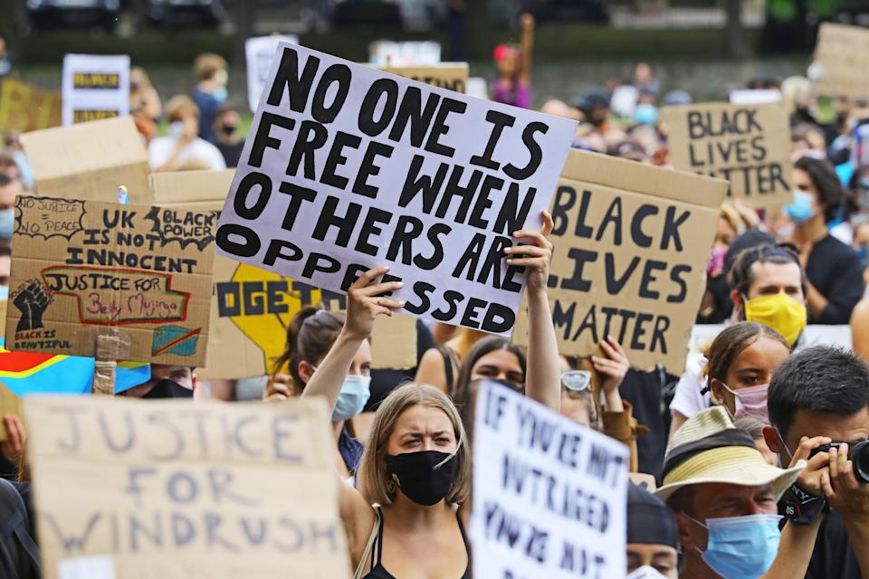 People take part in a Black Lives Matter protest in Brighton (PA Archive)