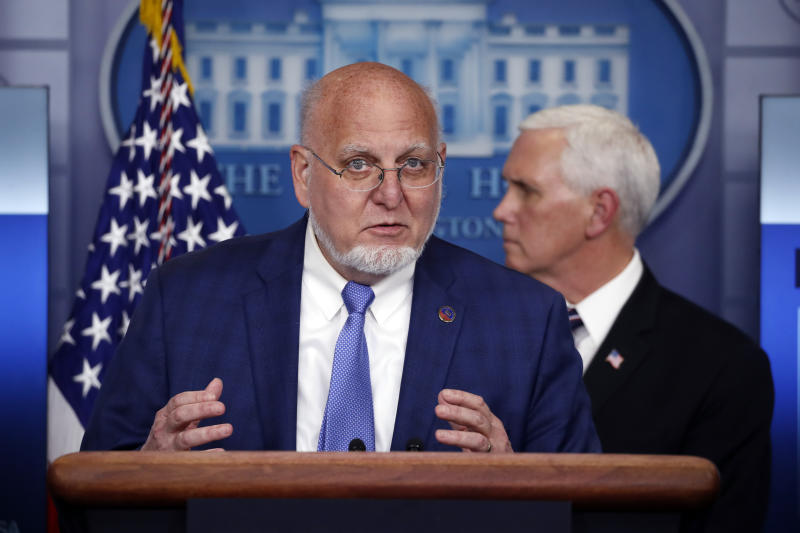 Dr. Robert Redfield, director of the Centers for Disease Control and Prevention, speaks about the coronavirus in the James Brady Press Briefing Room of the White House, Wednesday, April 8, 2020, in Washington, as Vice President Mike Pence watches. (AP Photo/Alex Brandon)