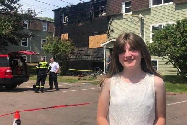 Maxine Warwick,12, woke up her neighbours to alert them of a fire in the middle of the night on June 23 on Norwood Road.  (Nicola Macleod/CBC - image credit)