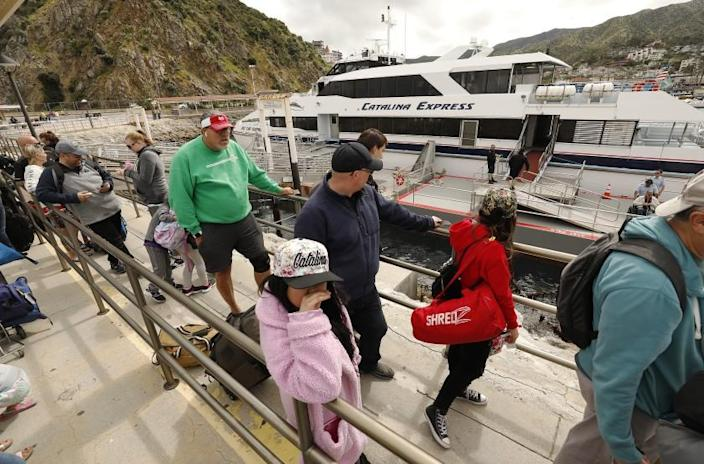 AVALON CATALINA ISLAND, CA - APRIL 16, 2019 - Passengers wait to board a Catalina Express vessel at the Boat Terminal at Avalon Catalina Island where a new Vons Avalon Market is popular on April 16, 2019. The popular new store is much larger than any previous food store on the island and offers much greater selection while retaining a quaint quality with a parking lot designed not for cars but for golf carts. (Al Seib / Los Angeles Times)