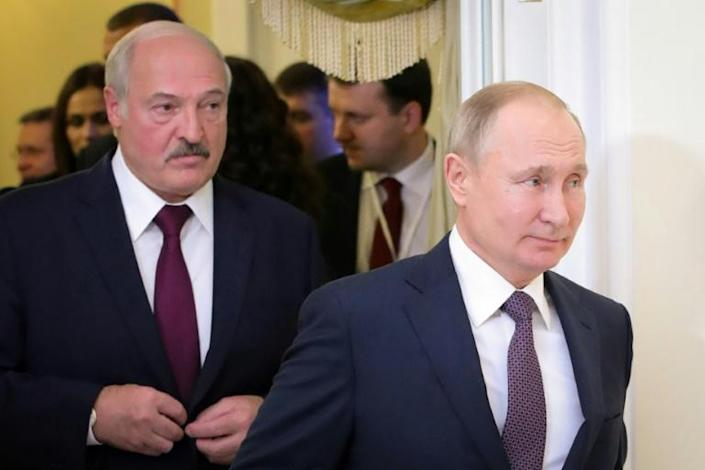 Alexander Lukashenko (L) may no longer be able to play Russia's Vladimir Putin off against the West