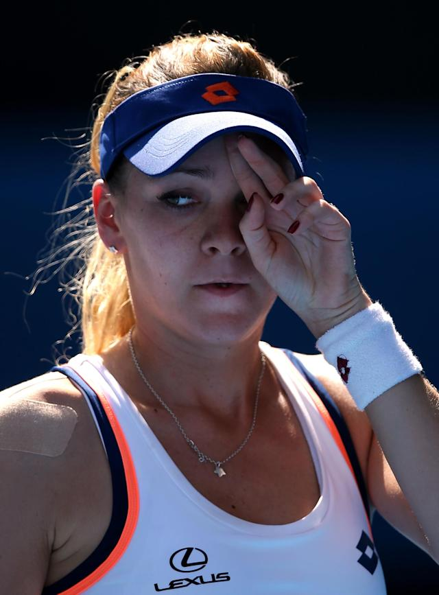 Agnieszka Radwanska of Poland reacts after losing a point to Dominika Cibulkova of Slovakia during their semifinal at the Australian Open tennis championship in Melbourne, Australia, Thursday, Jan. 23, 2014.(AP Photo/Aaron Favila)
