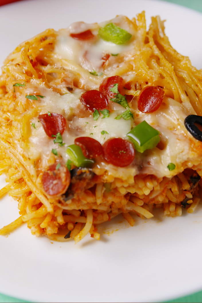 "<p>Pizza and spaghetti are meant to be.</p><p>Get the recipe from <a href=""https://www.delish.com/cooking/recipe-ideas/recipes/a57807/pizza-spaghetti-recipe/"" rel=""nofollow noopener"" target=""_blank"" data-ylk=""slk:Delish"" class=""link rapid-noclick-resp"">Delish</a>. </p>"