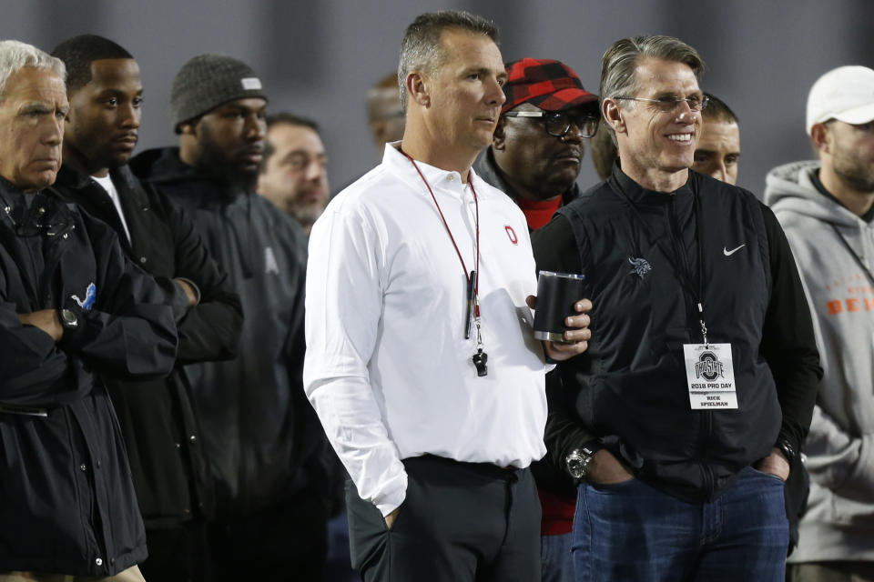 Ohio State head coach Urban Meyer watches players run drills during Ohio State's pro day in March. (AP)