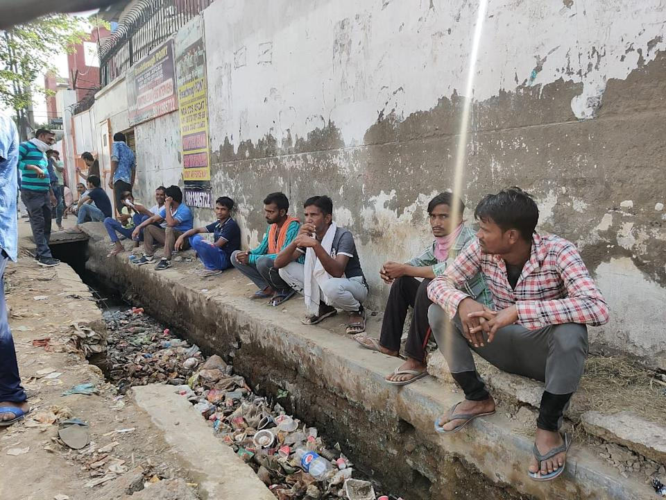 Hundreds of migrant labourers queue up at Noida's labour chowk every morning hoping to find a day's work.