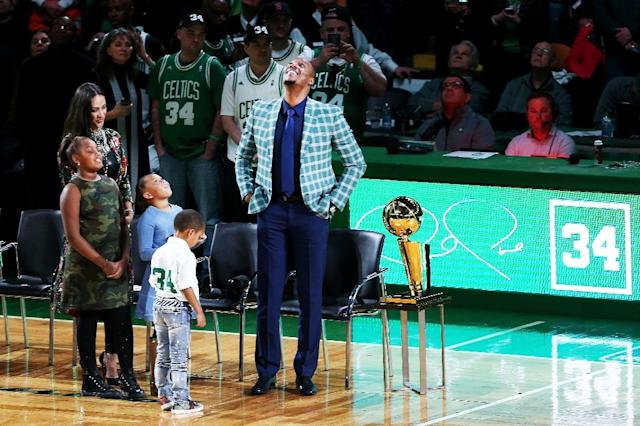 Despite the home team's loss, the night belonged to former Celtics player Paul Pierce and his family as they got to see his number 34 raised to the rafters of the Boston Garden arena (AFP Photo/Adam Glanzman)