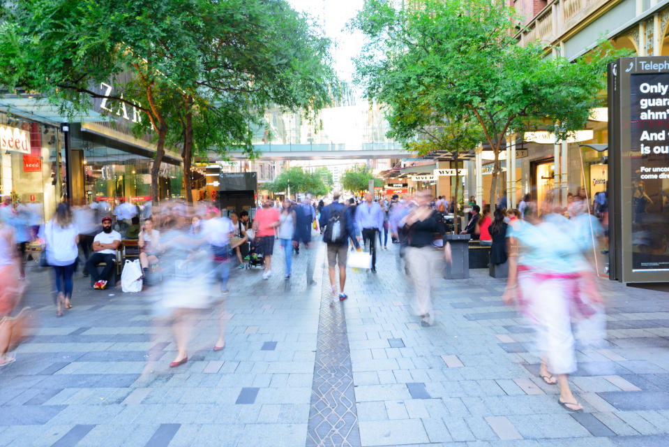 Sydney, Australia - November 10, 2015: Blurred people shoppers in central Sydney a nice summer day. Various signs, mix of people crowd, all zoom blurred. Blur made in lens, not post processing.